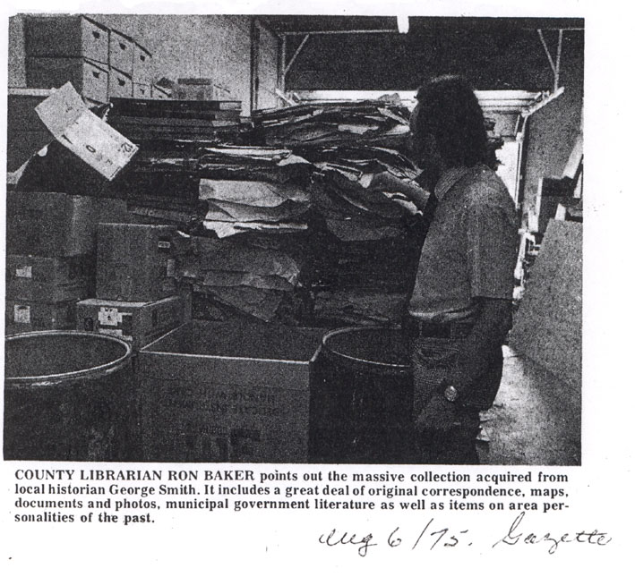 County Librarian Ron Baker points out massive collection acquired by George Smith, Sarnia Gazette,1975