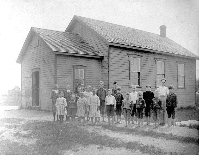 Children standing outside school.