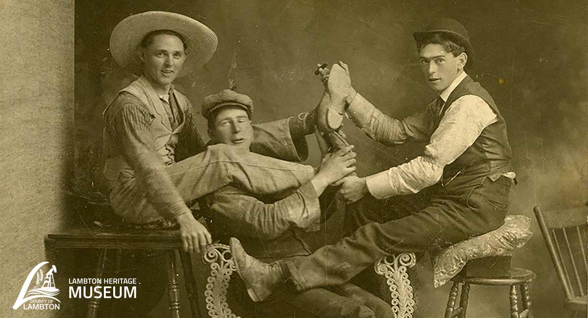 Image of three men entangled in a silly pose.