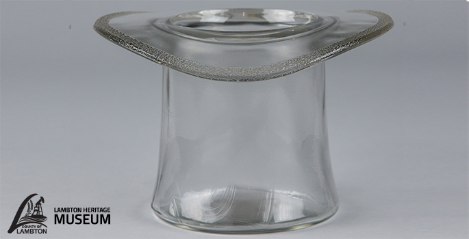 clear glass shaped in a top hat.