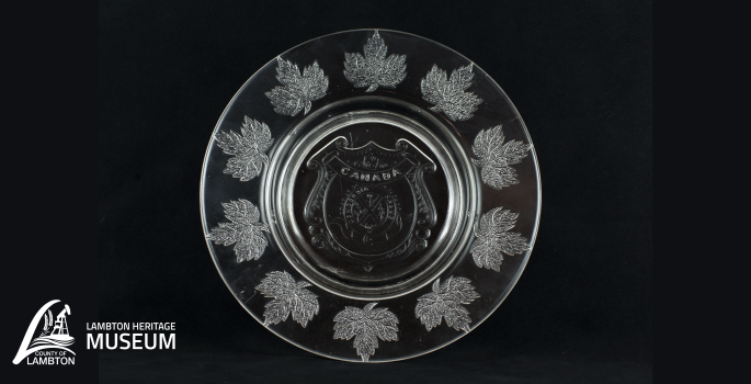Pressed glass plate shaped as a maple leaf.