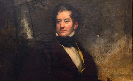 Painting portrait of a man sitting.