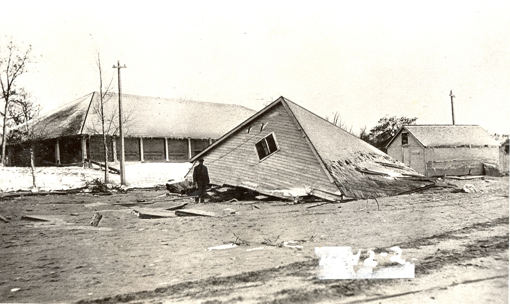 Black and white image of a building fallen down.