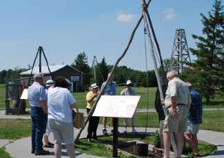 People around outdoor exhibit at the Oil Museum of Canada