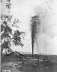 Black and white image of shooting a well using a torpedo.